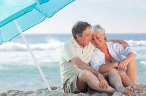 Couple enjoying beach in retirement
